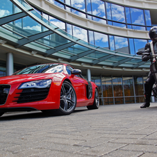 The image shows and Audi R8 and Ducati Diavel outside what appears to be the Audi headquarters