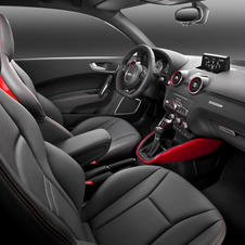 The interior receives standard sport seats and is finished in dark tones
