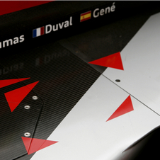 The only spot that the drivers can step on to get into the car in the area within those four red triangles