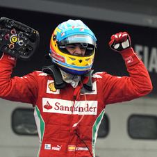 Alonso takes win in wet race in Sepang