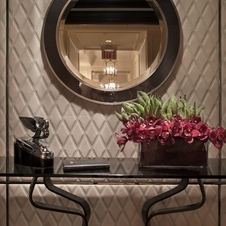 The entryway features a leather wall and leather tile